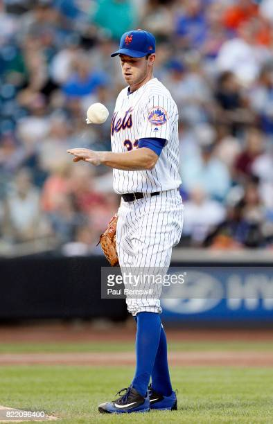 Pitcher Steven Matz of the New York Mets reacts with a rosin bag in an interleague MLB baseball game against the Oakland Athletics on July 21 2017 at...