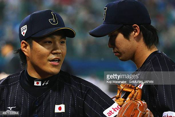 Pitcher Takahiro Norimoto of Japan returns to the dugout after the bottom of fifth inning during the WBSC Premier 12 match between the United States...