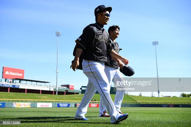 Pitcher Takahiro Norimoto and Pitcher Tomoyuki Sugano of Japan are seen prior to the exhibition game between Japan and Chicago Cubs at Sloan Park on...