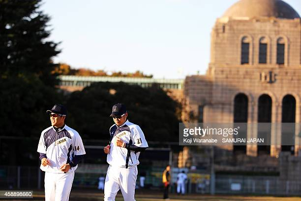 Pitcher Takahiro Norimoto and Pitcher Yuki Nishi of Samurai Japan in action during a training session at Jing Gaien Field on November 13 2014 in...
