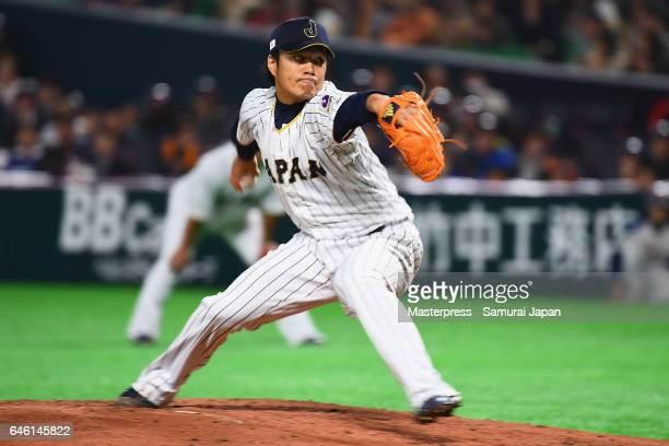 Pitcher Takahiro Norimoto of Japan delivers a pitch in the top of the second inning during SAMURAI JAPAN Sendoff Friendly Match between Japan and...