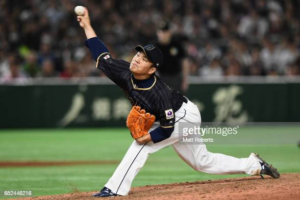 Pitcher Takahiro Norimoto of Japan thros in the bottom of the ninth inning during the World Baseball Classic Pool E Game Two between Japan and...