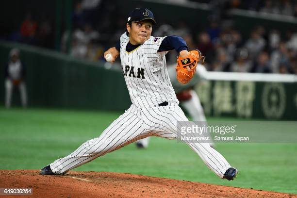 Pitcher Takahiro Norimoto of Japan throws in the top of the fifth inning during the World Baseball Classic Pool B Game One between Cuba and Japan at...