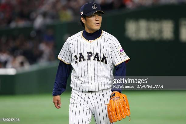 Pitcher Takahiro Norimoto of Japan walks to the dugout after the top of the fifth inning during the World Baseball Classic Pool B Game One between...