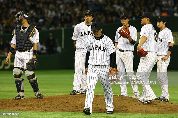 Pitcher Takahiro Norimoto walks off the mound in the top of ninth inning during the WBSC Premier 12 semi final match between South Korea and Japan at...