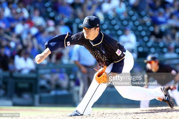 Pitcher Takahiro Norimoto#14 in action in the bottom half of the eigth inning during the exhibition game between Japan and Chicago Cubs at Sloan Park...