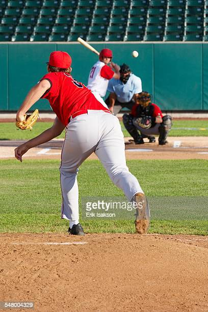 Pitcher throwing ball to batter