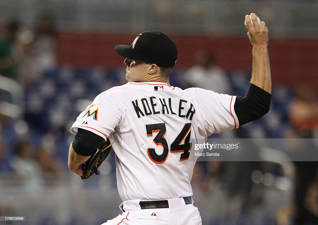Pitcher Tom Koehler 334 of the Miami Marlins throws against the St. Louis Cardinals during the first inning at Marlins Park on June 15, 2013 in Miami, Florida.