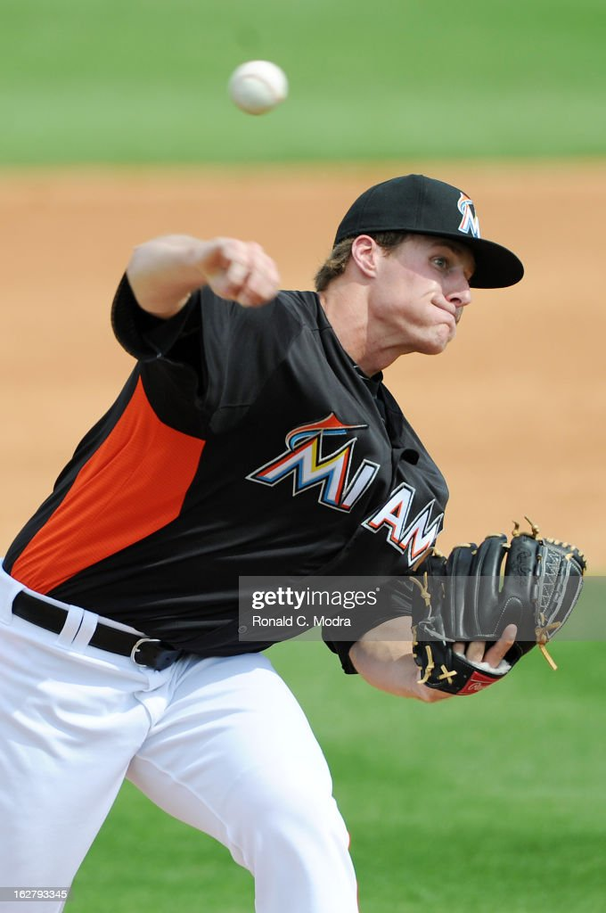 Pitcher Tom Koehler #34 of the Florida Marlins pitches during a spring training game against the St. Louis Cardinals at Roger Dean Stadium on February 23, 2013 in Jupiter, Florida.