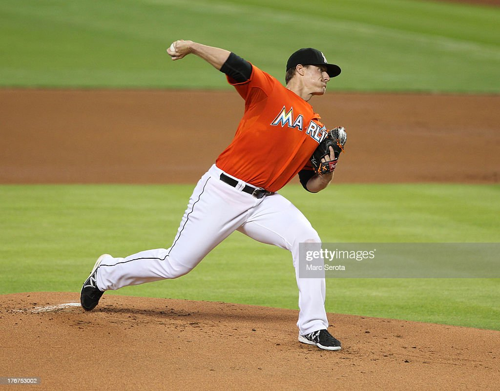 Pitcher Tom Koehler #34 of the Miami Marlins throws against the San Francisco Giants at Marlins Park on August 18, 2013 in Miami, Florida.