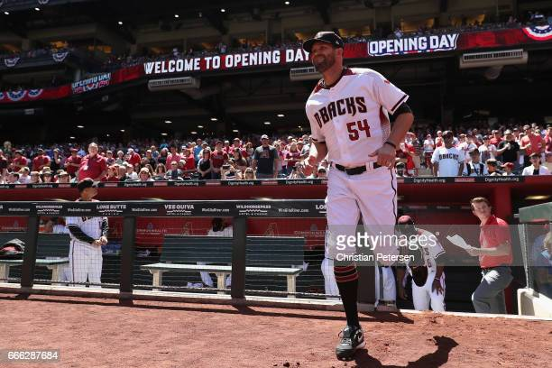 Pitcher Tom Wilhelmsen of the Arizona Diamondbacks runs onto the field for introductions before the MLB opening day game against the San Francisco...