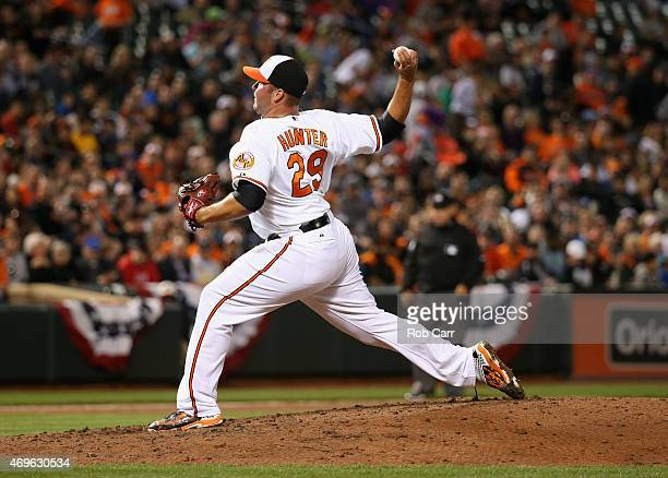 Pitcher Tommy Hunter of the Baltimore Orioles throws to a New York Yankees batter in the seventh inning of the Orioles 65 loss at Oriole Park at...
