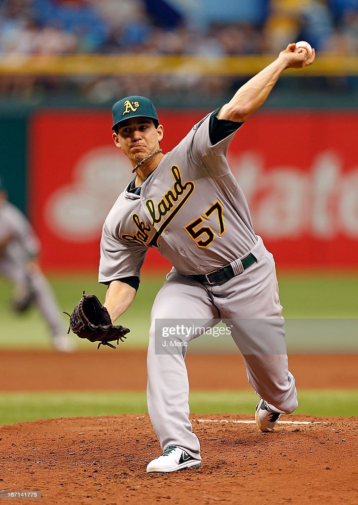 Pitcher <a gi-track='captionPersonalityLinkClicked' href=/galleries/search?phrase=Tommy+Milone&family=editorial&specificpeople=8240408 ng-click='$event.stopPropagation()'>Tommy Milone</a> #57 of the Oakland Athletics pitches against the Tampa Bay Rays during the game at Tropicana Field on April 21, 2013 in St. Petersburg, Florida.