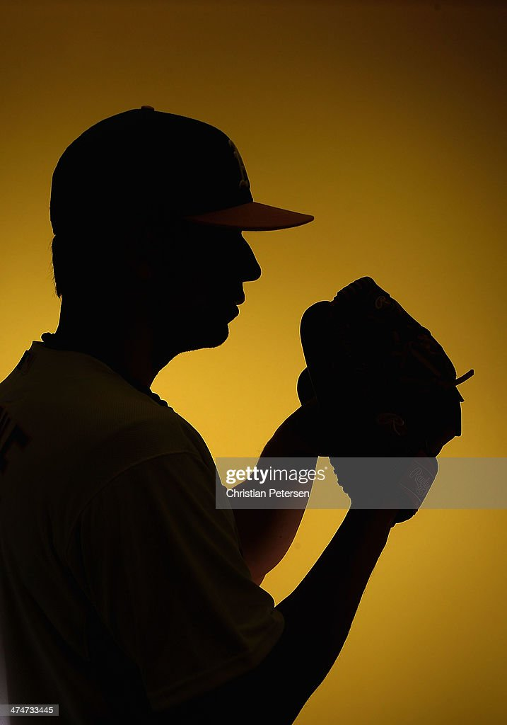 Pitcher Tommy Milone #57 of the Oakland Athletics poses for a portrait during the spring training photo day at Phoenix Municipal Stadium on February 22, 2014 in Phoenix, Arizona.