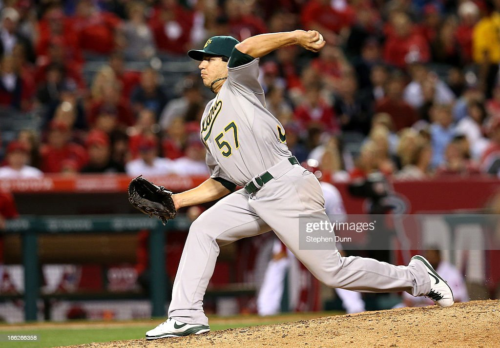 Pitcher Tommy Milone #547 of the Oakland Athletics throws a pitch against the Los Angeles Angels of Anaheim at Angel Stadium of Anaheim on April 10, 2013 in Anaheim, California.