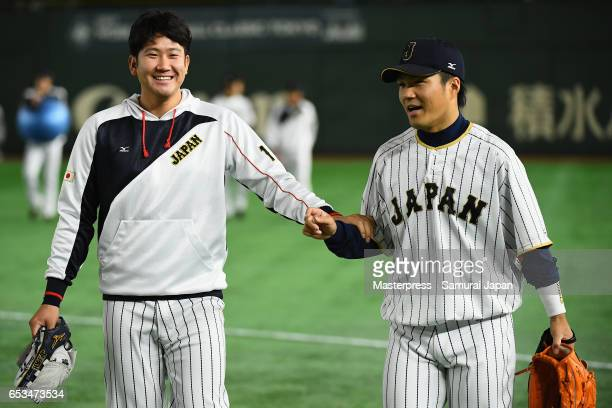 Pitcher Tomoyuki Sugano and Pitcher Takahiro Norimoto of Japan talk prior to the World Baseball Classic Pool E Game Six between Israel and Japan at...