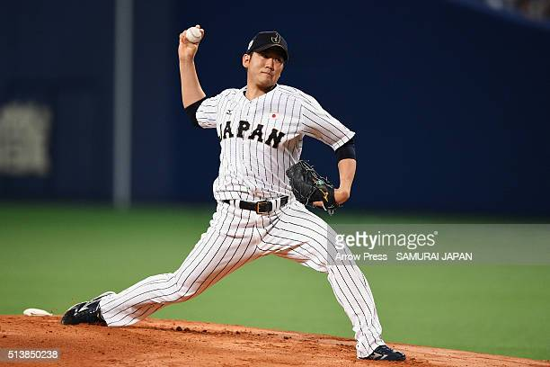 Pitcher Tomoyuki Sugano of Japan delivers a pitch in the top of first inning during the international friendly match between Japan and Chinese Taipei...