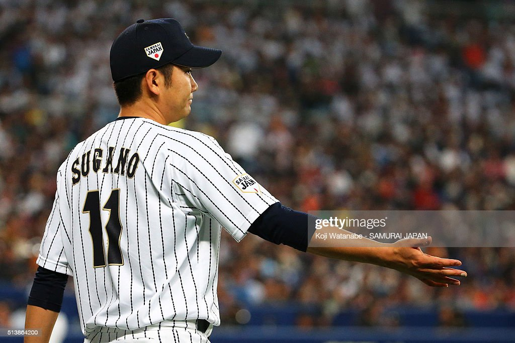 Pitcher Tomoyuki Sugano #11 of Japan in action during the international friendly match between Japan and Chinese Taipei at the Nagoya Dome on March 5, 2016 in Nagoya, Aichi, Japan.