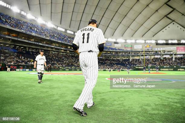 Pitcher Tomoyuki Sugano of Japan is seen prior to the World Baseball Classic Pool E Game Four between Cuba and Japan at the Tokyo Dome on March 14...