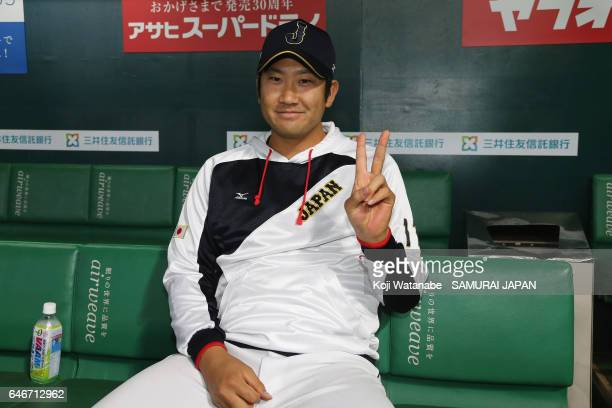 Pitcher Tomoyuki Sugano of Japan poses for photographs after his team's win in the SAMURAI JAPAN Sendoff Friendly Match between CPBL Selected Team...
