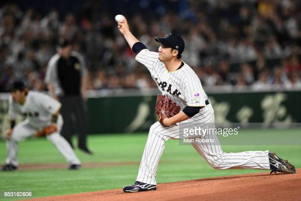 Pitcher Tomoyuki Sugano of Japan throws in the top of the first inning during the World Baseball Classic Pool E Game Four between Cuba and Japan at...