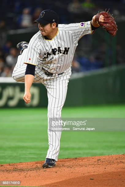 Pitcher Tomoyuki Sugano of Japan throws in the top of the fourth inning during the World Baseball Classic Pool E Game Four between Cuba and Japan at...