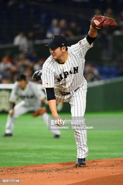 Pitcher Tomoyuki Sugano of Japan throws in the top of the second inning during the World Baseball Classic Pool E Game Four between Cuba and Japan at...