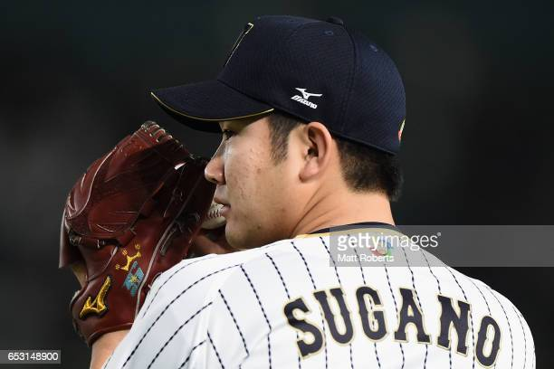 Pitcher Tomoyuki Sugano of Japan warms up prior to the World Baseball Classic Pool E Game Four between Cuba and Japan at the Tokyo Dome on March 14...