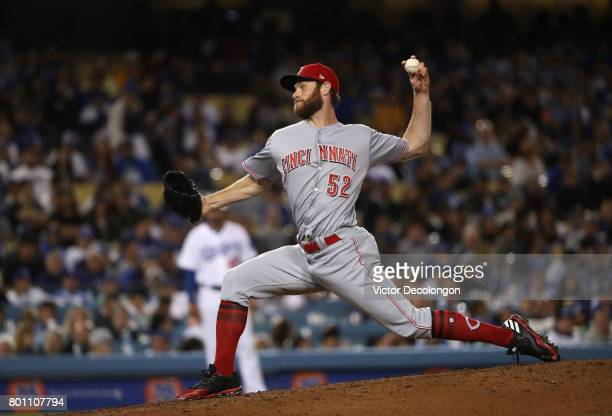 Pitcher Tony Cingrani of the Cincinnati Reds pitches in the eighth inning during the MLB game Los Angeles Dodgers at Dodger Stadium on June 9 2017 in...