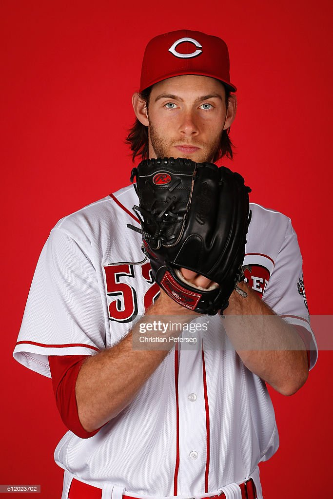 Pitcher Tony Cingrani of the Cincinnati Reds poses for a portrait during spring training photo day at Goodyear Ballpark on February 24 2016 in...