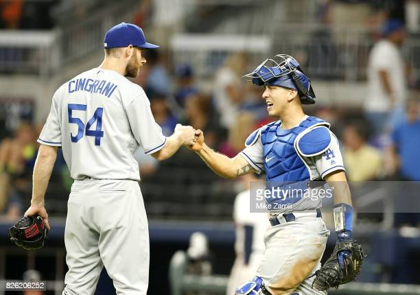 Pitcher Tony Cingrani of the Los Angeles Dodgers is congratulated by catcher Austin Barnes after the game against the Atlanta Braves on August 3 2017...