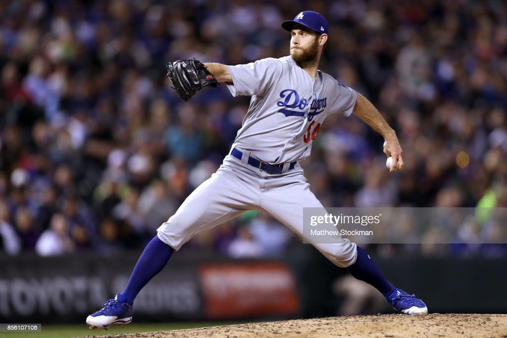 Pitcher Tony Cingrani #54 of the Los Angeles Dodgers throws in the seventh inning against the Coloarado Rockies at Coors Field on September 30, 2017 in Denver, Colorado.