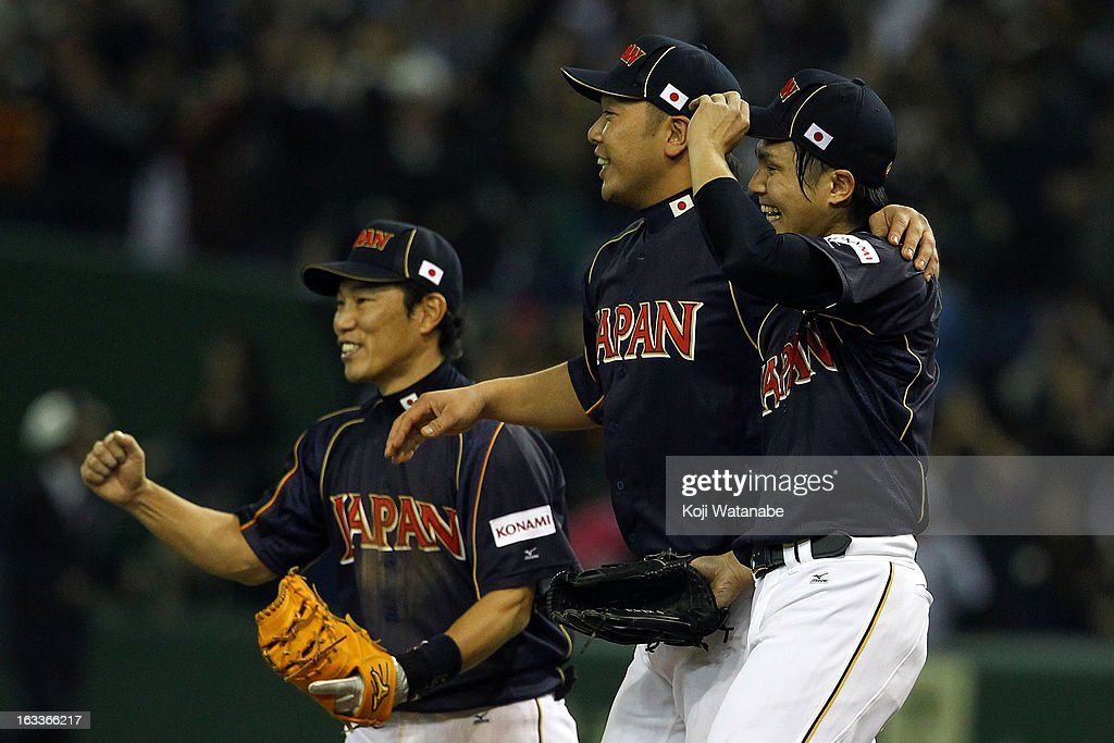 Pitcher <a gi-track='captionPersonalityLinkClicked' href=/galleries/search?phrase=Toshiya+Sugiuchi&family=editorial&specificpeople=843038 ng-click='$event.stopPropagation()'>Toshiya Sugiuchi</a> (R) #18, Catcher <a gi-track='captionPersonalityLinkClicked' href=/galleries/search?phrase=Shinnosuke+Abe&family=editorial&specificpeople=2708810 ng-click='$event.stopPropagation()'>Shinnosuke Abe</a> #10 (C) and infielder <a gi-track='captionPersonalityLinkClicked' href=/galleries/search?phrase=Hirokazu+Ibata&family=editorial&specificpeople=2922541 ng-click='$event.stopPropagation()'>Hirokazu Ibata</a> #3 of Japan celebrate after winning the World Baseball Classic Second Round Pool 1 game between Japan and Chinese Taipei at Tokyo Dome on March 8, 2013 in Tokyo, Japan.