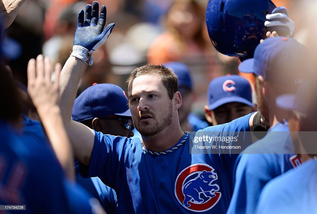 Pitcher Travis Wood #37 of the Chicago Cubs is congratulated by teammates after he hit a solo home run in the fifth inning against the San Francisco Giants at AT&T Park on July 28, 2013 in San Francisco, California.