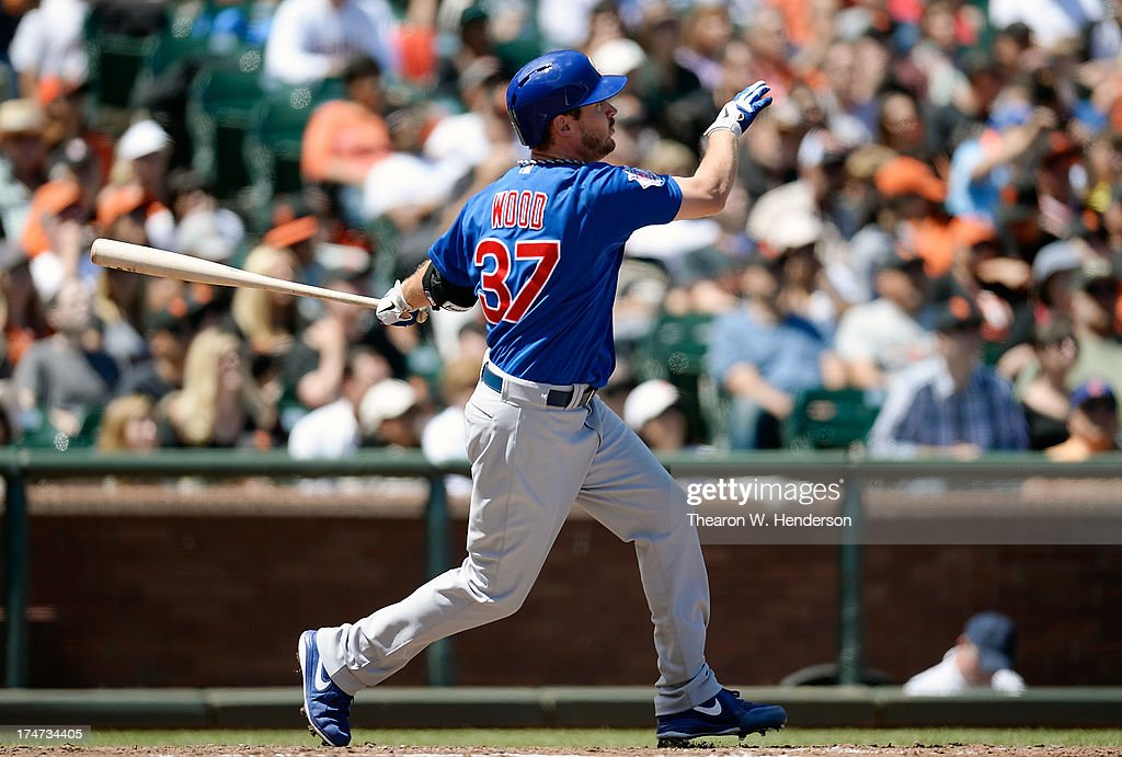 Pitcher Travis Wood #37 of the Chicago Cubs swings and watches the flight of his ball as he hits a solo home run in the fifth inning against the San Francisco Giants at AT&T Park on July 28, 2013 in San Francisco, California.