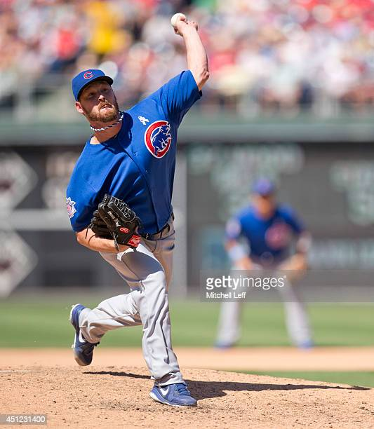 Pitcher Travis Wood of the Chicago Cubs throws a pitch against the Philadelphia Phillies on June 15 2014 at Citizens Bank Park in Philadelphia...