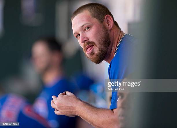 Pitcher Travis Wood of the Chicago Cubs watches the game from the dugout in the top of the ninth inning against the Philadelphia Phillies on June 15...