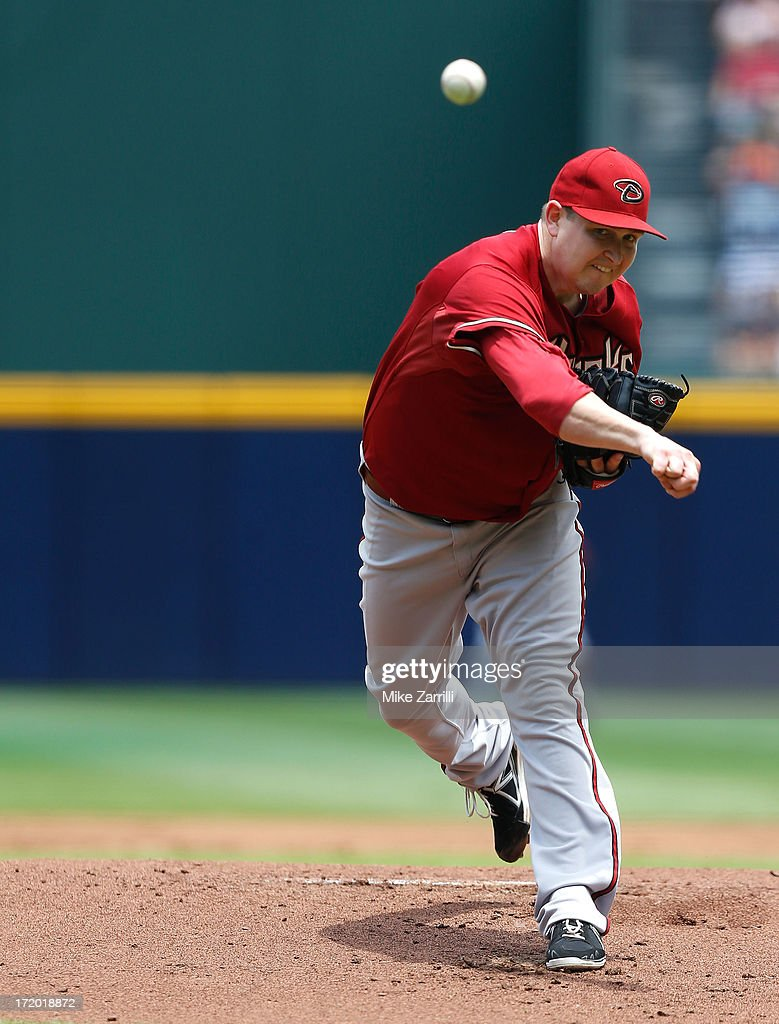Pitcher <a gi-track='captionPersonalityLinkClicked' href=/galleries/search?phrase=Trevor+Cahill&family=editorial&specificpeople=5437061 ng-click='$event.stopPropagation()'>Trevor Cahill</a> #35 of the Arizona Diamondbacks throws a pitch during the game against the Atlanta Braves at Turner Field on June 30, 2013 in Atlanta, Georgia.