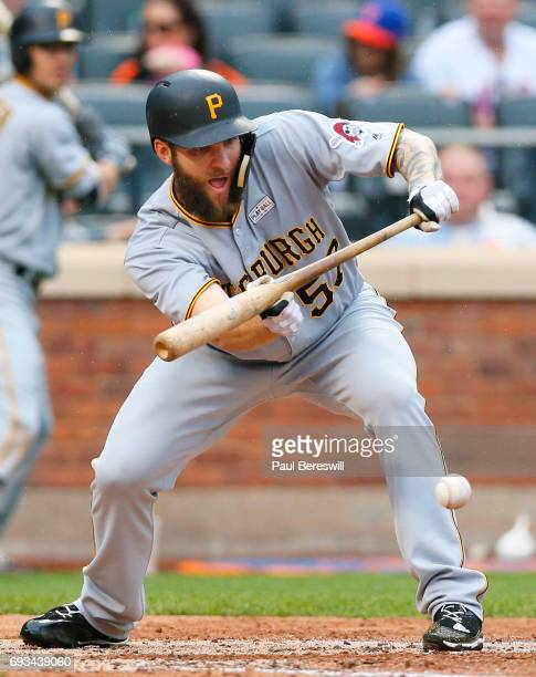 Pitcher Trevor Williams of the Pittsburgh Pirates lays down a bunt in an MLB baseball game against the New York Mets on June 4 2017 at CitiField in...