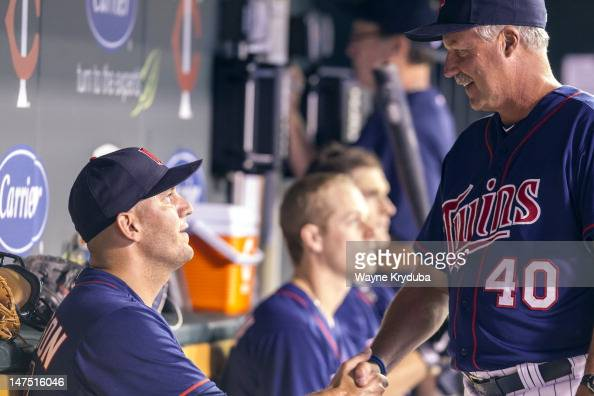 Pitcher Tyler Robertson Justin Morneau Josh Willingham and Rick Anderson of the Minnesota Twins in the dugout after Tyler Robertson makes his major...