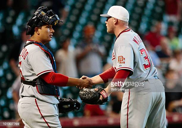 Pitcher Tyler Walker of the Washington Nationals shakes hands with catcher Carlos Maldondo after the final out against the Houston Astros at Minute...
