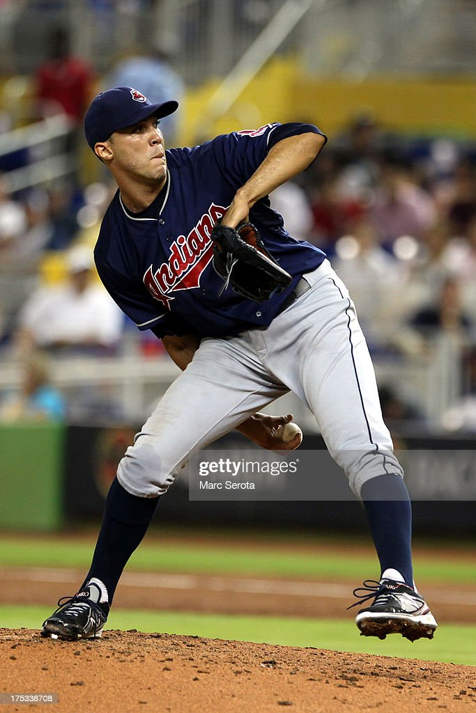 Pitcher <a gi-track='captionPersonalityLinkClicked' href=/galleries/search?phrase=Ubaldo+Jimenez&family=editorial&specificpeople=2539590 ng-click='$event.stopPropagation()'>Ubaldo Jimenez</a> #30 of the Cleveland Indians throws against the Miami Marlins at Marlins Park on August 2, 2013 in Miami, Florida.