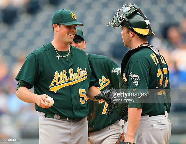 Pitcher Vin Mazzaro of the Oakland Athletics talks with catcher Landon Powell in a game against the Kansas City Royals on July 18 2010 at Kauffman...