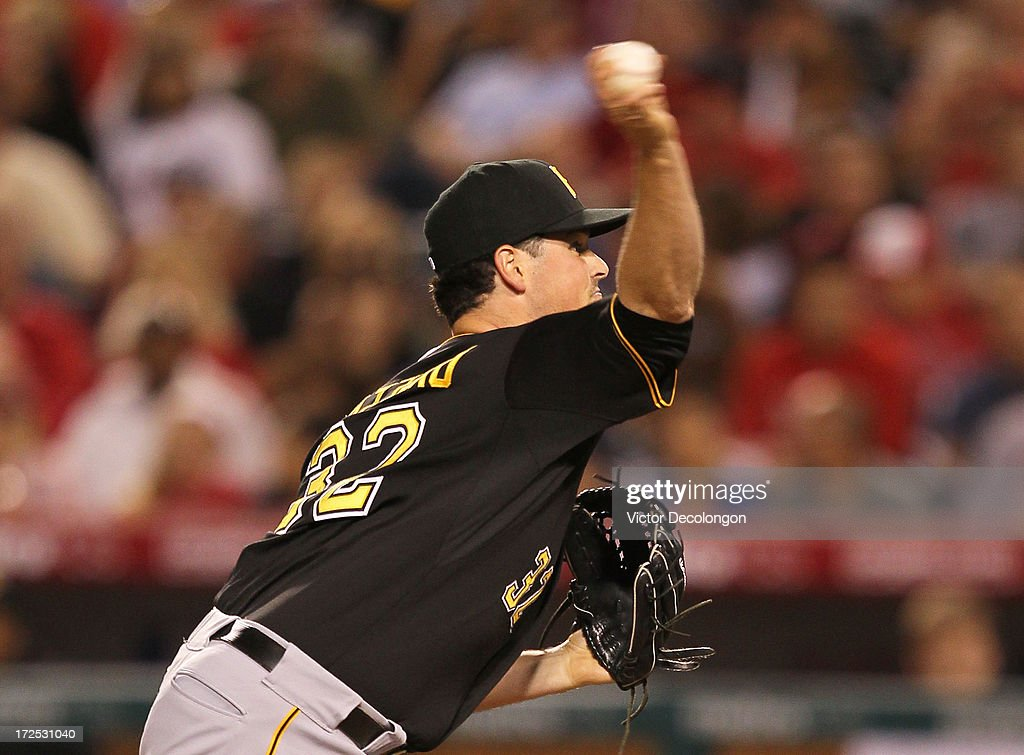 Pitcher <a gi-track='captionPersonalityLinkClicked' href=/galleries/search?phrase=Vin+Mazzaro&family=editorial&specificpeople=5759050 ng-click='$event.stopPropagation()'>Vin Mazzaro</a> #32 of the Pittsburgh Pirates pitches in relief for Gerrit Cole #45 (not in photo) in the seventh inning during the MLB game against the Los Angeles Angels of Anaheim at Angel Stadium of Anaheim on June 21, 2013 in Anaheim, California. The Pirates defeated the Angels 5-2.