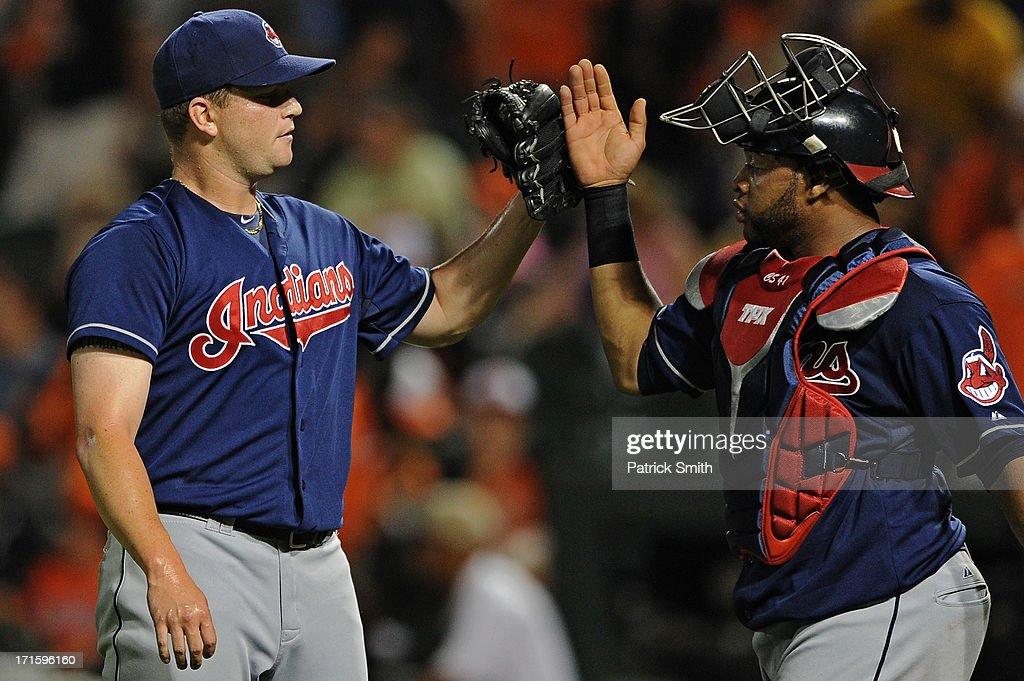 Pitcher <a gi-track='captionPersonalityLinkClicked' href=/galleries/search?phrase=Vinnie+Pestano&family=editorial&specificpeople=4583581 ng-click='$event.stopPropagation()'>Vinnie Pestano</a> #52 of the Cleveland Indians celebrates with catcher Carlos Santana #41 of the Cleveland Indians after defeating the Baltimore Orioles at Oriole Park at Camden Yards on June 26, 2013 in Baltimore, Maryland. The Cleveland Indians won, 4-3.