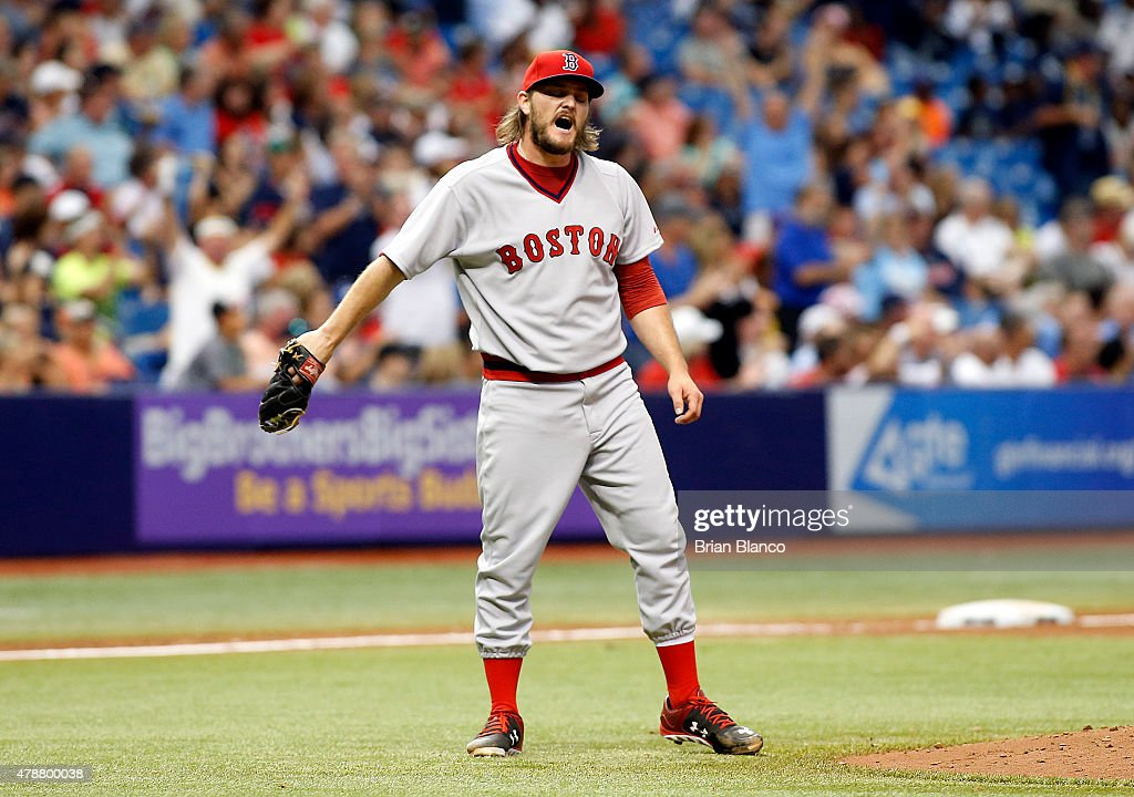 Pitcher Wade Miley of the Boston Red Sox reacts on the mound after giving up a tworun home run to Jake Elmore of the Tampa Bay Rays during the fifth...