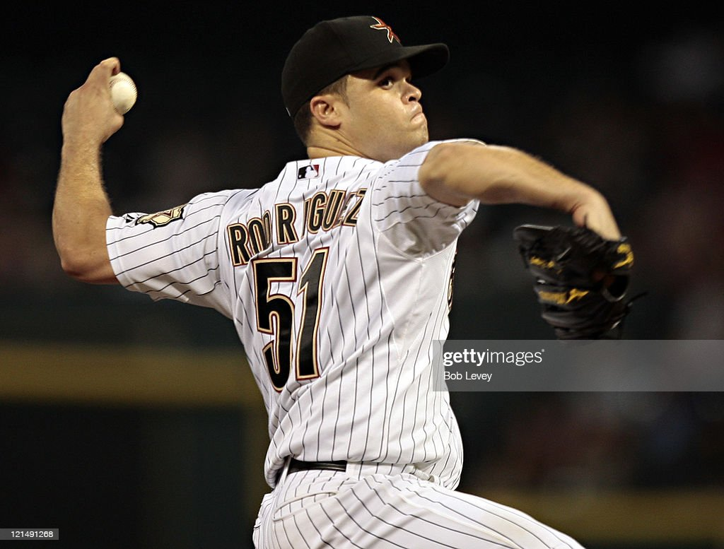 Pitcher <a gi-track='captionPersonalityLinkClicked' href=/galleries/search?phrase=Wandy+Rodriguez&family=editorial&specificpeople=247781 ng-click='$event.stopPropagation()'>Wandy Rodriguez</a> #51 of the Houston Astros throws against the San Francisco Giants in the first inning at Minute Maid Park on August 19, 2011 in Houston, Texas.