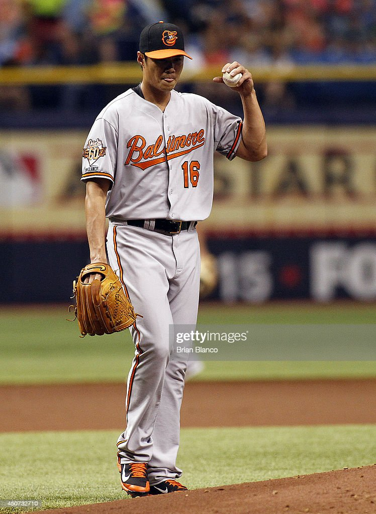 Pitcher <a gi-track='captionPersonalityLinkClicked' href=/galleries/search?phrase=Wei-Yin+Chen&family=editorial&specificpeople=8958243 ng-click='$event.stopPropagation()'>Wei-Yin Chen</a> #16 of the Baltimore Orioles reacts after allowing a double to Evan Longoria (not pictured) of the Tampa Bay Rays during the first inning of a game on June 16, 2014 at Tropicana Field in St. Petersburg, Florida.