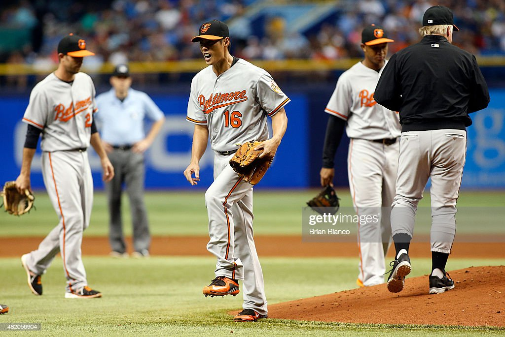 Pitcher Wei-Yin Chen #16 of the Baltimore Orioles reacts as he is taken off the mound by manager Buck Showalter #26 during the sixth inning of a game against the Tampa Bay Rays on July 26, 2015 at Tropicana Field in St. Petersburg, Florida.