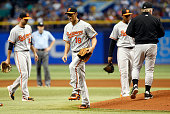Pitcher WeiYin Chen of the Baltimore Orioles reacts as he is taken off the mound by manager Buck Showalter during the sixth inning of a game against...